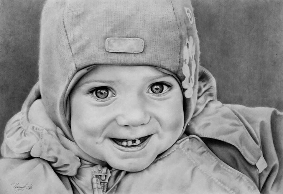 Portrait of smiling child with hat and outer coat